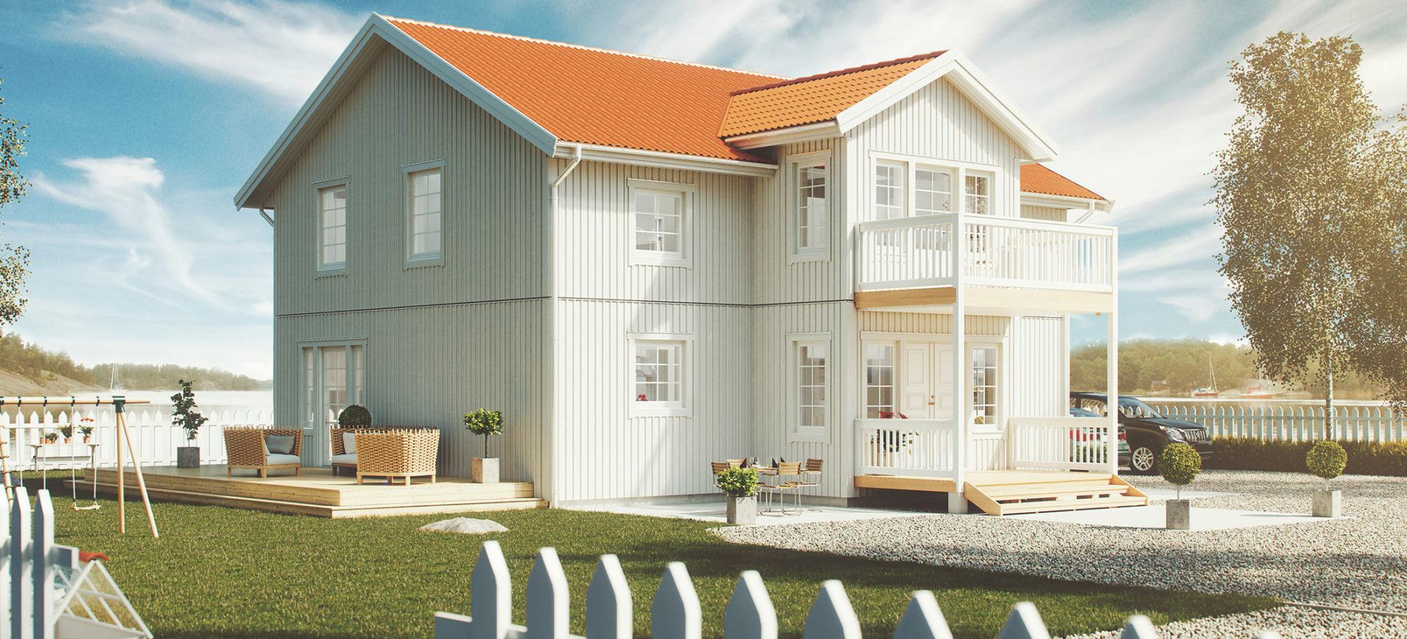 Herrgårdsinspirerat tvåplanshus. Vit fasad och rött tak.